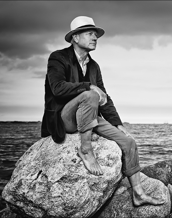 Christian Kaiser is a professional Photographer and Guide Image; sitting at the baltic Sea